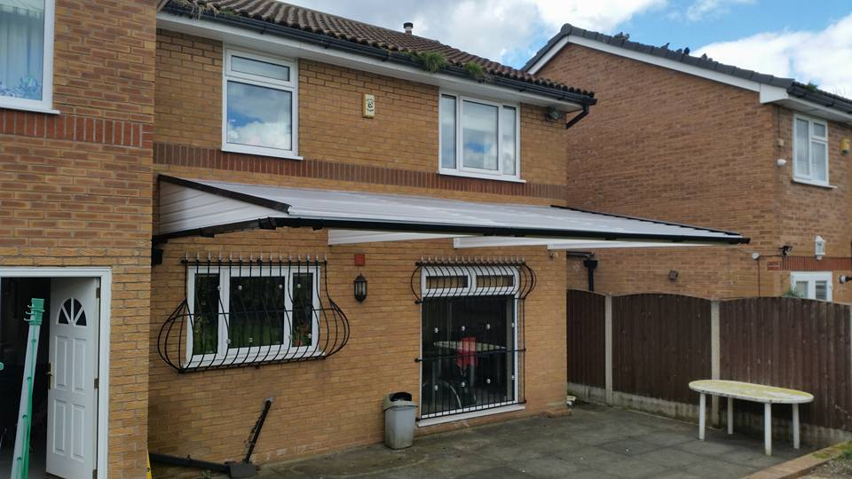 Cantilever Canopy covering the patio in the garden & Carports Smoking Shelters and Canopies from Sovereign Awnings